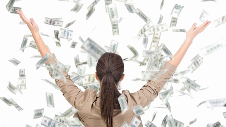 Woman throwing money in the air showing success of vegan business sector