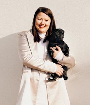 Hilary MacMillan vegan designer holding dog
